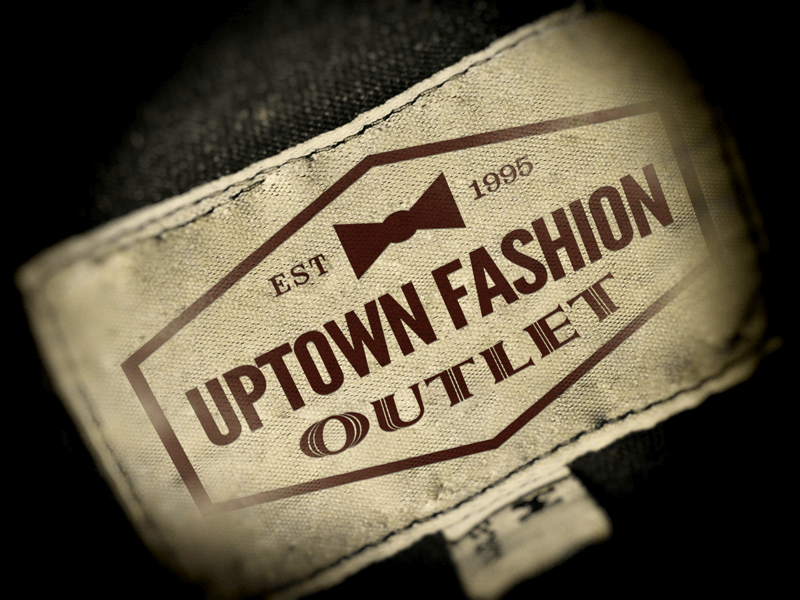 Mockup image of Uptown Fashion retail logo designed by David Trotter @bluedotagency