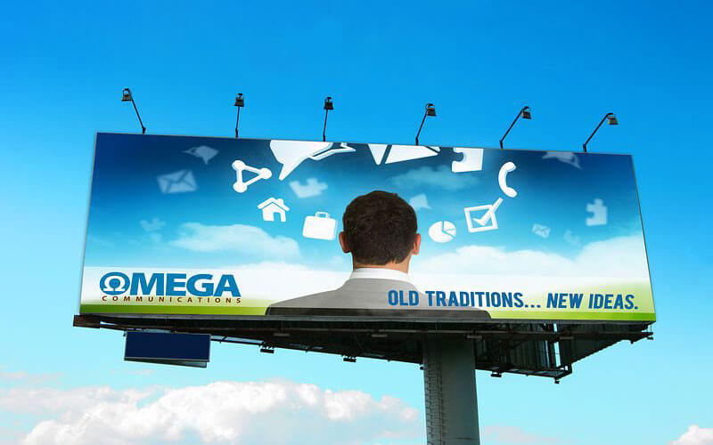 Billboard for Omega Communications designed by David Trotter @bluedotagency