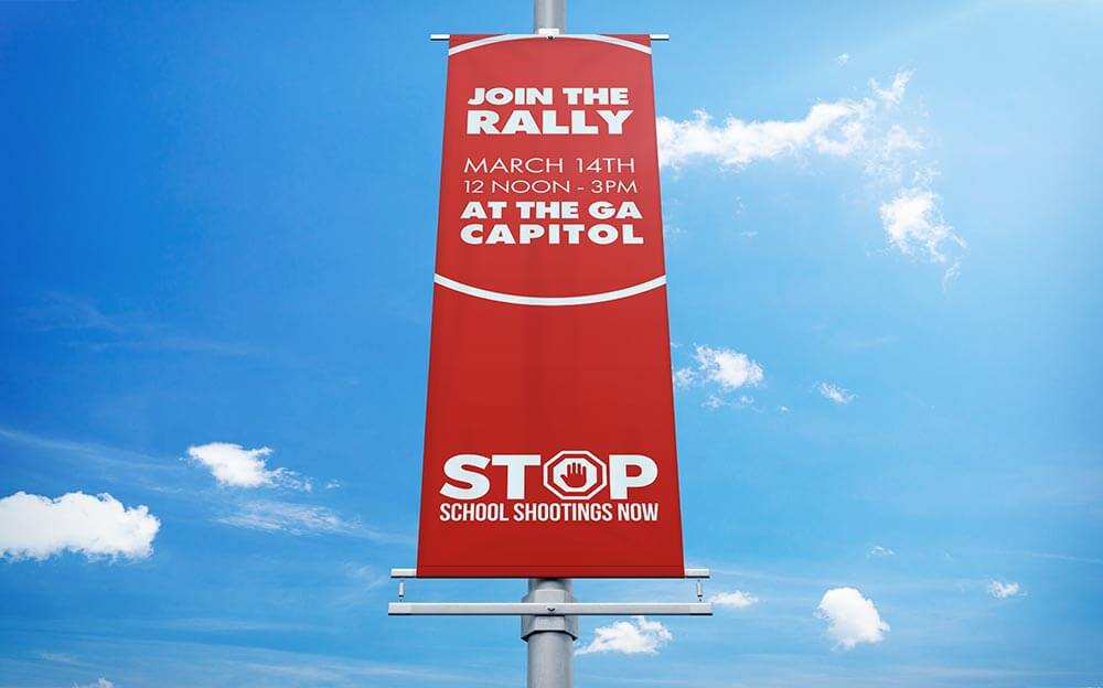 Blue Dot Agency sign design for Stop School Shootings Rally & March